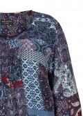 Fröhliche Bluse mit buntem Muster /