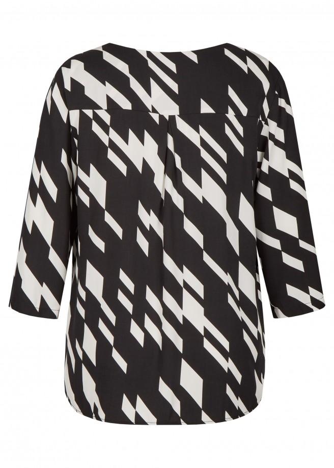 Modische Bluse mit monochromem Muster /